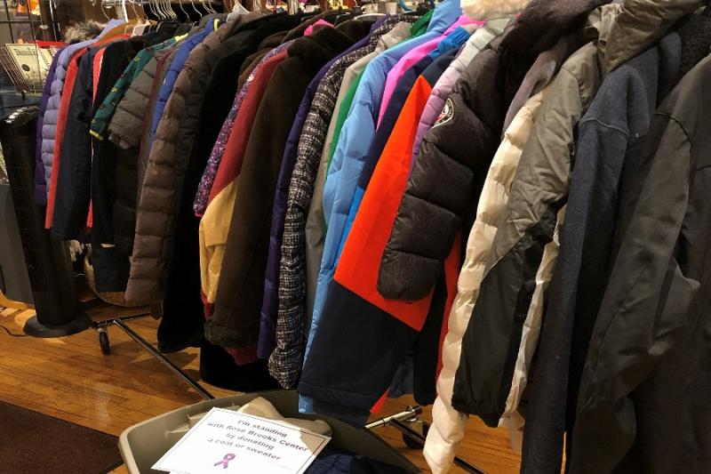 Coat donations sorted and new donations arriving at World's Window in Kansas City, Missouri