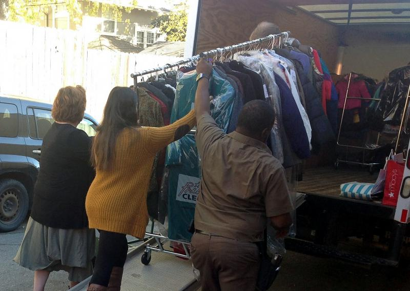Racks of donated coats are loaded on the truck headed to the domestic violence shelter at Rose Brooks Center