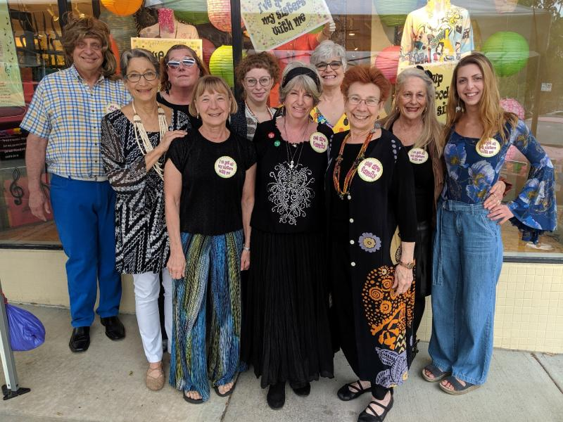 World's Window staff dressed for 70's fun at Flipping Favorites 2019