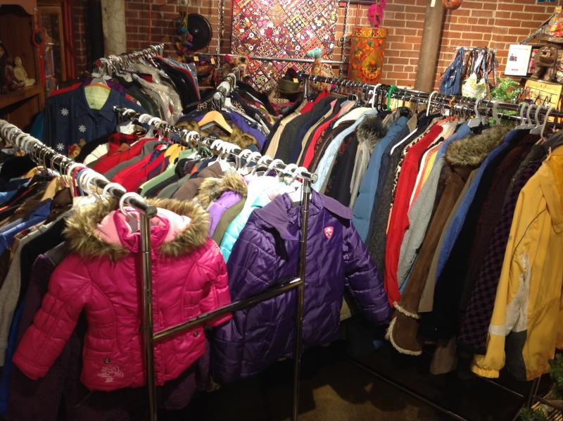 Racks of donated coats ready for the domestic violence shelter at Rose Brooks Center